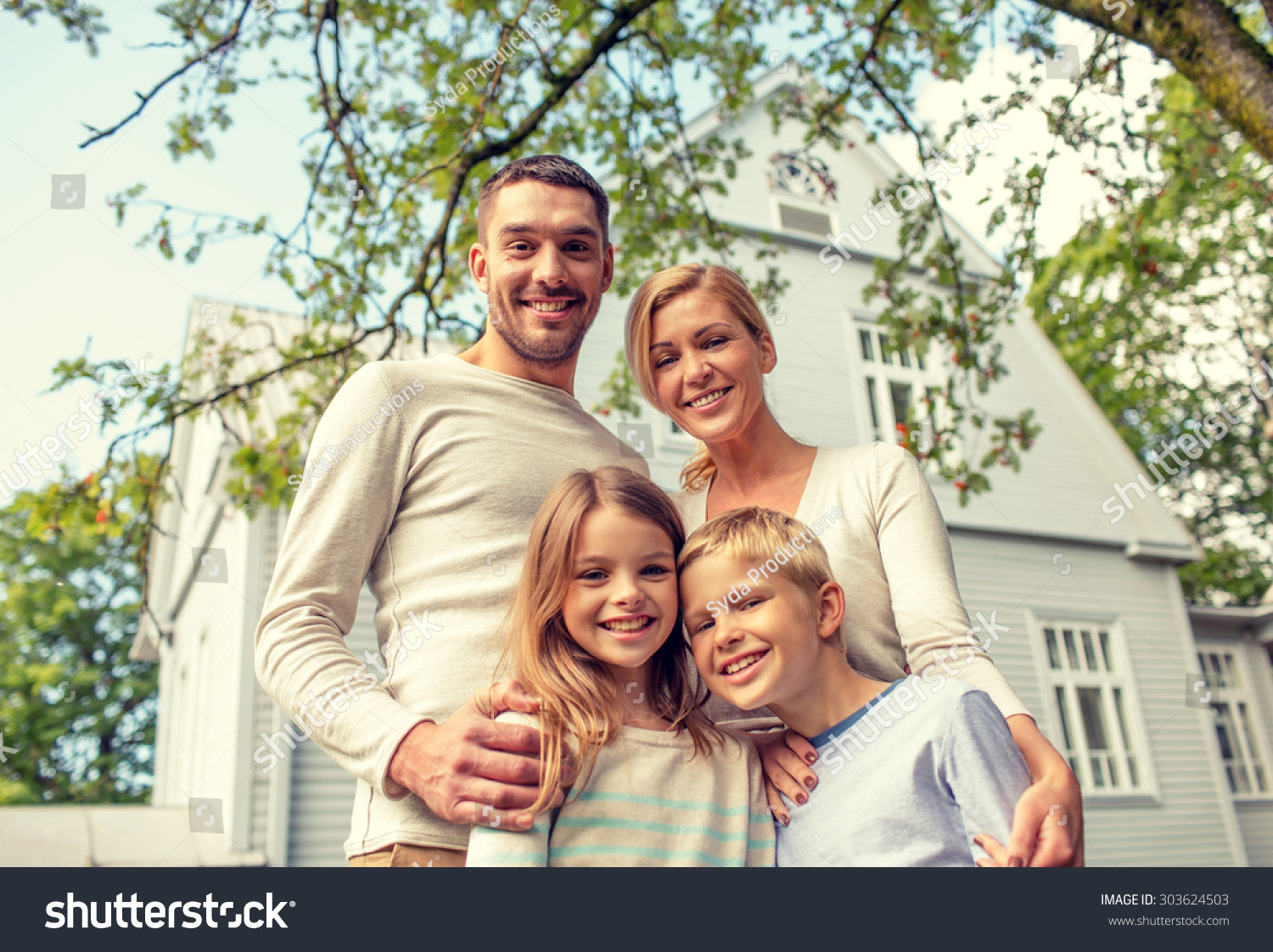 Stock photo of family in front of house