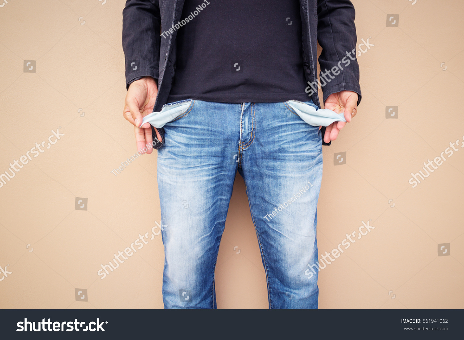 Man with empty out-turned pockets